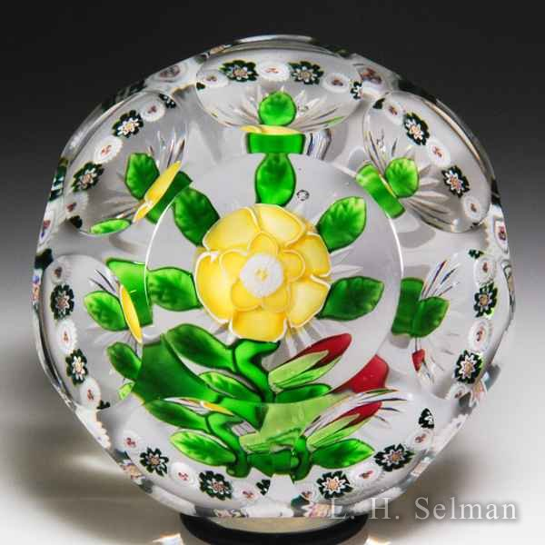 Antique Baccarat yellow buttercup and red bud faceted glass paperweight. by  Baccarat Antique