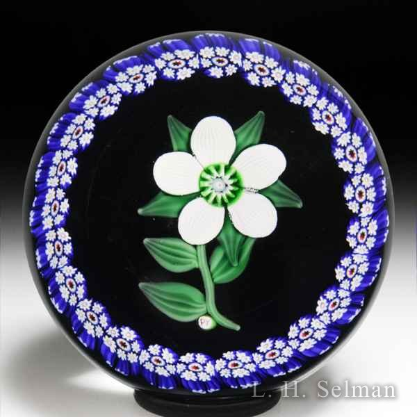 Paul Ysart white clematis and millefiori garland paperweight. by Paul Ysart