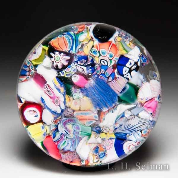 Antique New England Glass Company end-of-day scrambled millefiori and silhouettes paperweight. by American