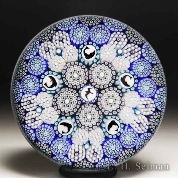 Mike Hunter 2018 close concentric millefiori with seagull and dolphins patterned glass paperweight. by Twists Glass Studio