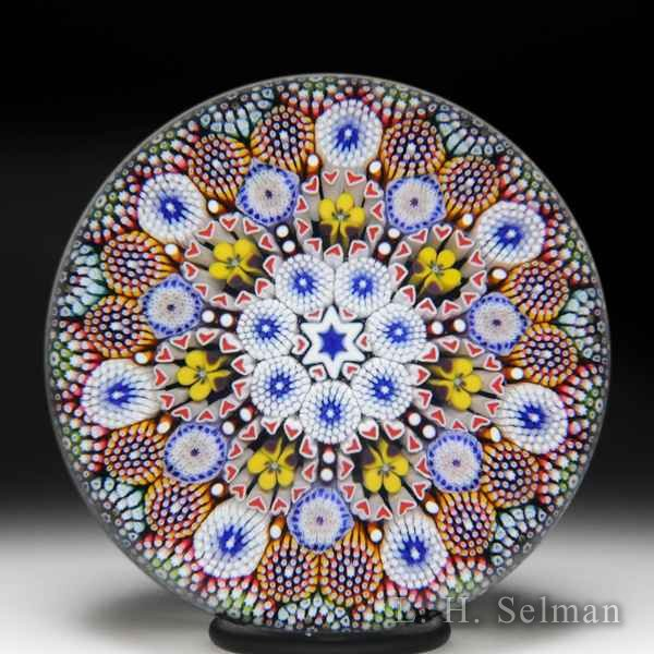Mike Hunter 2018 close concentric patterned millefiori and pansies glass paperweight. by Twists Glass Studio