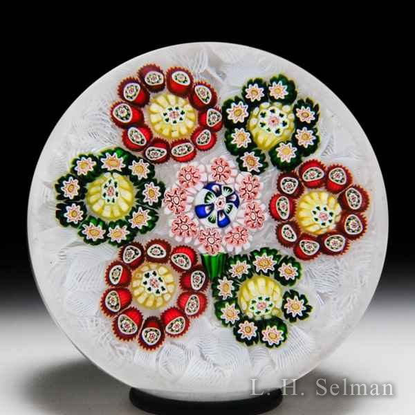 Rare antique Baccarat patterned millefiori circlets with shamrocks glass paperweight. by  Baccarat Antique