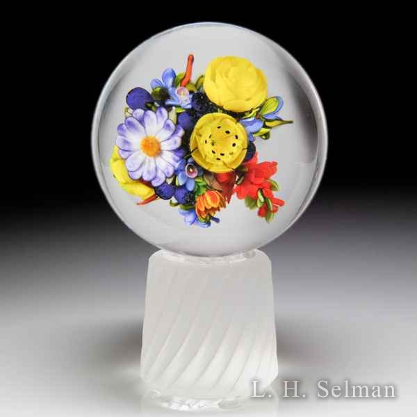 Mayauel Ward 2018 yellow roses, red sprays, blueberries and purple daisy bouquet orb and stand. by Mayauel Ward