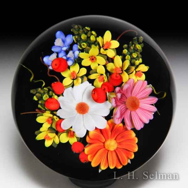 Mayauel Ward 2018 daisy, yellow flower spray and red berry bouquet footed glass paperweight. by Mayauel Ward