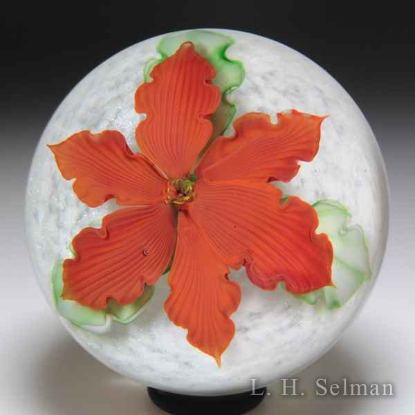 Mayauel Ward 2018 red poinsettia over white sodden snow compound glass paperweight. by Mayauel Ward