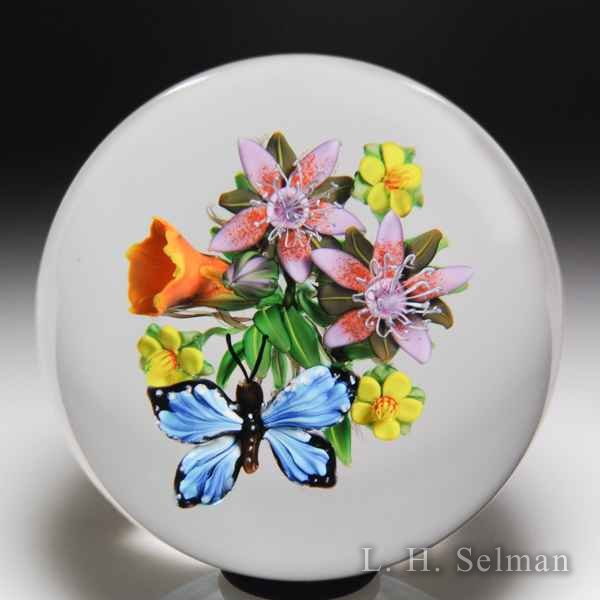 Ken Rosenfeld 2018 blue butterfly and orange trumpet flower bouquet paperweight. by Ken Rosenfeld