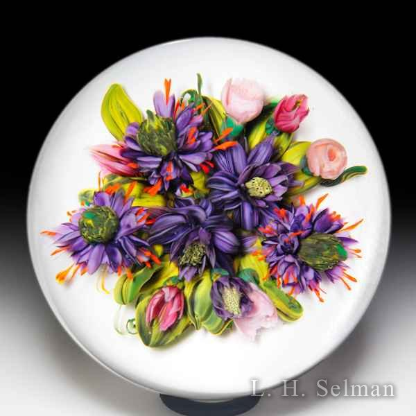 Melissa Ayotte (2018) purple dahlia bouquet on sodden snow glass paperweight. by Melissa Ayotte