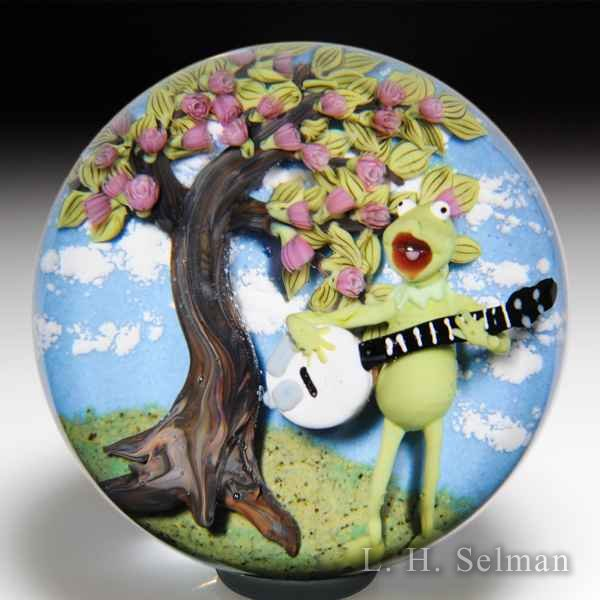 Clinton Smith 2018 Kermit the Frog with banjo singing under a tree glass paperweight. by Clinton Smith
