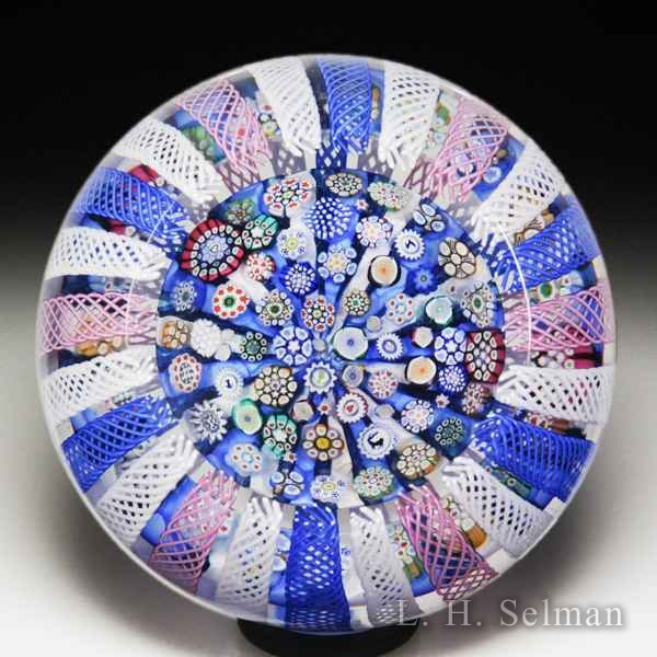 John Deacons 2018 scattered millefiori on striped cushion inside a crown overlay faceted glass paperweight. by John Deacons