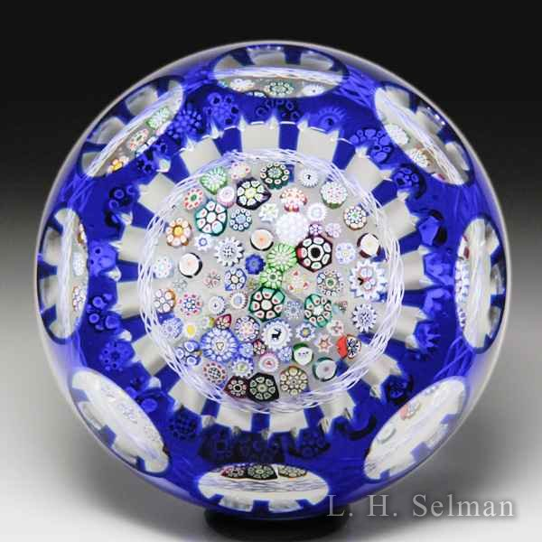 John Deacons 2018 close packed millefiori overlay faceted glass paperweight. by John Deacons