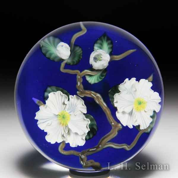 Lundberg Studios 1990 'Apple Blossoms' paperweight, by Daniel Salazar. by Lundberg Studios