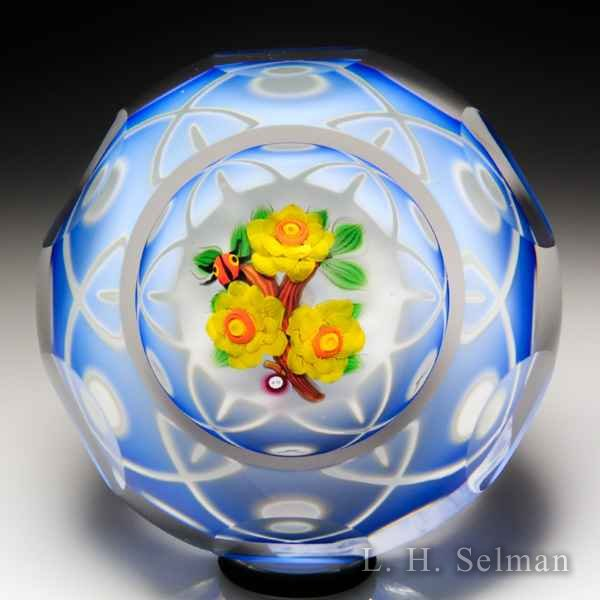 John Deacons rose bouquet and ladybug blue encased double overlay faceted glass paperweight. by John Deacons