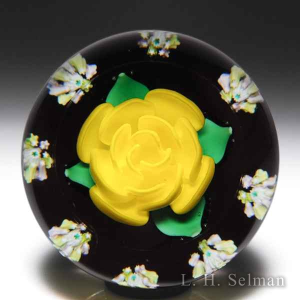 Charles Kaziun Junior yellow crimp rose and millefiori garland paperweight. by Charles Kaziun Junior