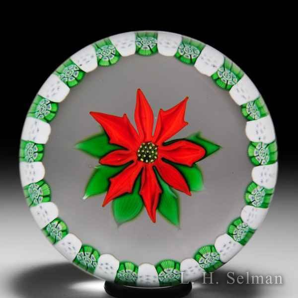 Perthshire Paperweights (1976) Christmas poinsettia and millefiori garland paperweight. by Perthshire Paperweights