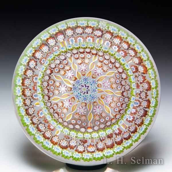Perthshire Paperweights patterned millefiori and radial twists faceted glass paperweight. by  Perthshire Paperweights