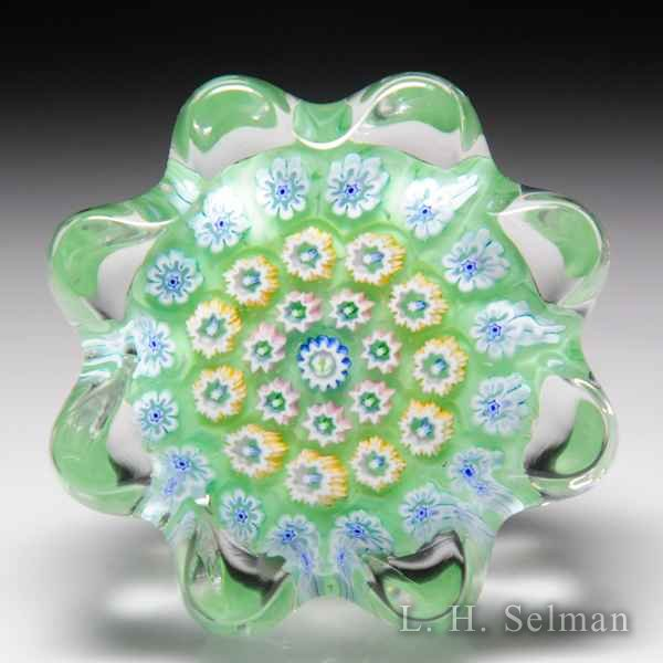 John Deacons (2019) open concentric millefiori daisy-pressed miniature glass paperweight. by John Deacons