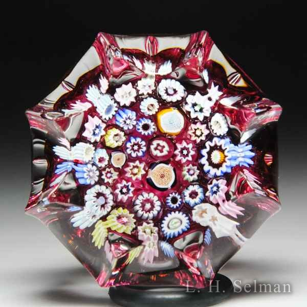 John Deacons (2019) spaced millefiori star-pressed miniature glass paperweight. by John Deacons