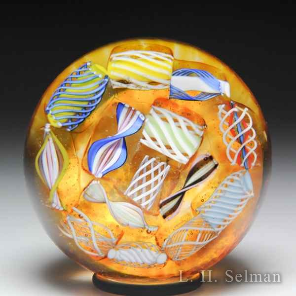 John Deacons (2019) end-of-day scrambled latticinio miniature glass paperweight. by John Deacons