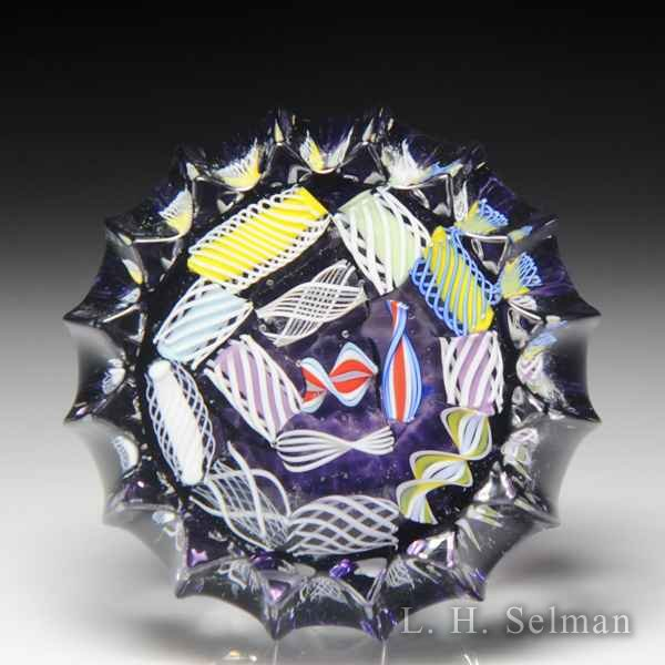 John Deacons (2019) end-of-day scrambled latticinio fluted miniature glass paperweight. by John Deacons