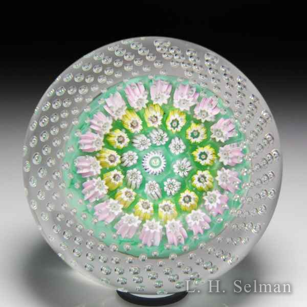 John Deacons (2019) open concentric millefiori with spaced air bubbles glass paperweight. by John Deacons