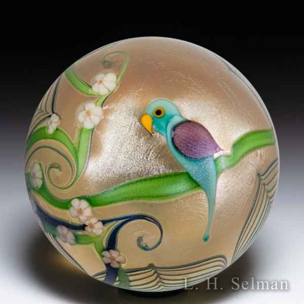 Orient & Flume 1979 purple parrot on green branch surface design glass paperweight. by  Orient & Flume