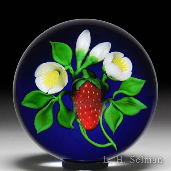 Victor Trabucco 1987 red strawberry with white blossoms glass paperweight. by Victor Trabucco