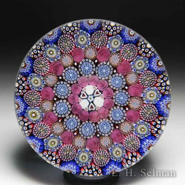 Mike Hunter 2019 close concentric millefiori and pink roses glass paperweight. by Twists Glass Studio