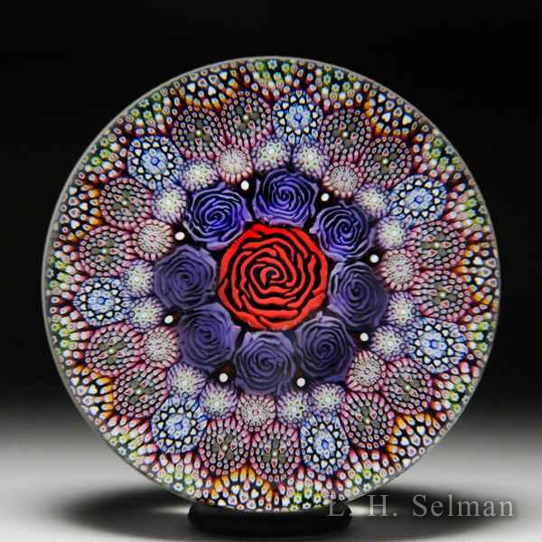 Mike Hunter 2019 close concentric roses and millefiori glass paperweight. by Twists Glass Studio