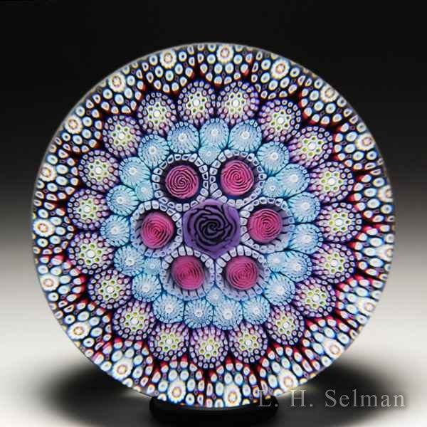 Mike Hunter 2019 close concentric millefiori and roses glass paperweight. by Twists Glass Studio