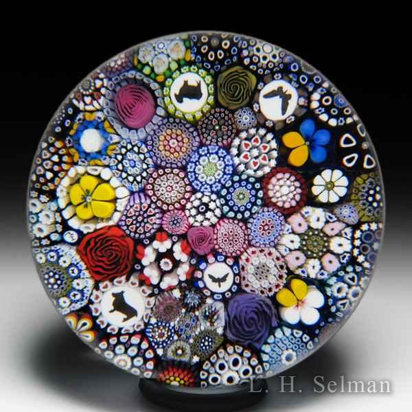 Mike Hunter 2019 close packed millefiori and silhouettes glass paperweight. by Twists Glass Studio