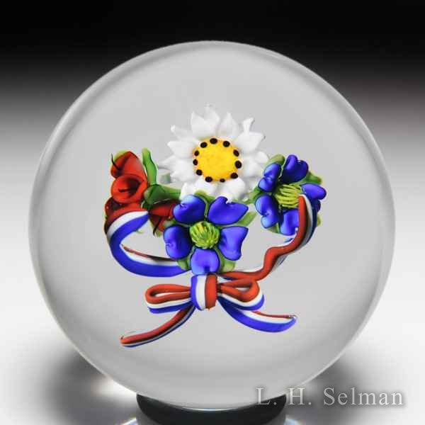 Ken Rosenfeld 2002 'Spirit of America' red, white and blue flowers and bow glass paperweight. by Ken Rosenfeld