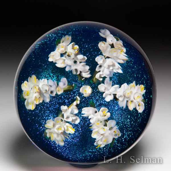 Melissa Ayotte 2018 white lilac star glass paperweight. by Melissa Ayotte