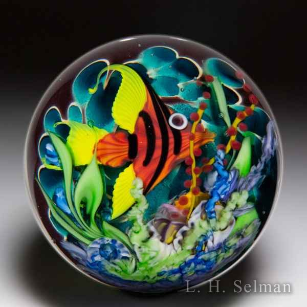 Mayauel Ward 2019 red angelfish in coral reef compound glass paperweight. by Mayauel Ward