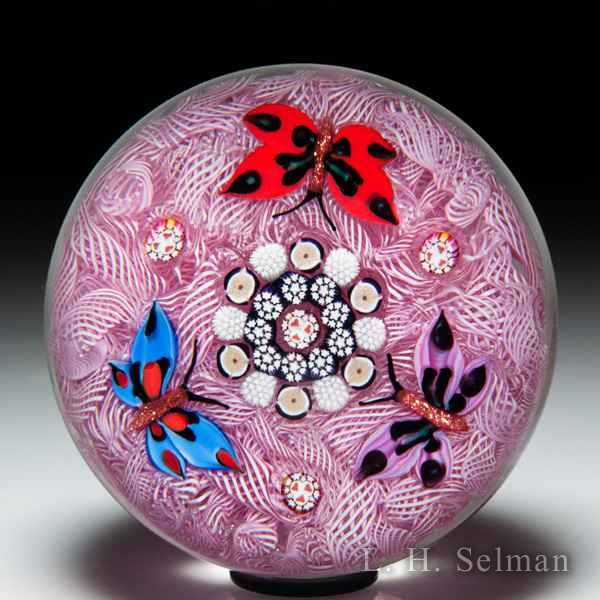John Deacons 2019 lampwork butterfly trio on upset muslin glass paperweight. by John Deacons