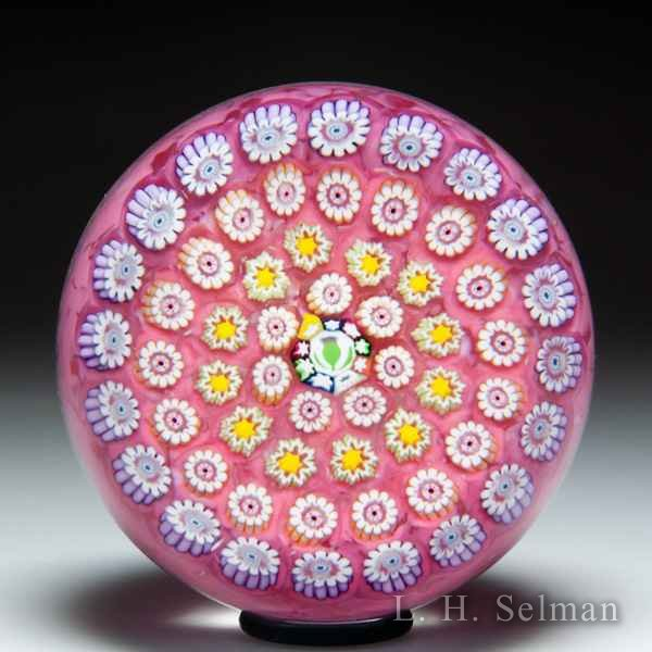 John Deacons close concentric millefiori glass paperweight. by John Deacons