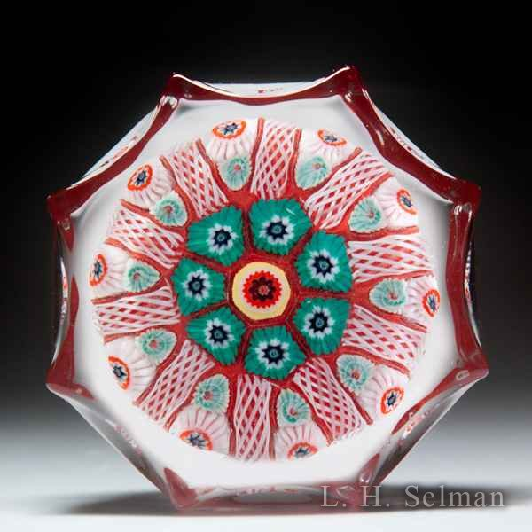 Strathearn patterned millefiori and latticinio spokes pressed star-shaped glass paperweight. by  Strathearn Glass