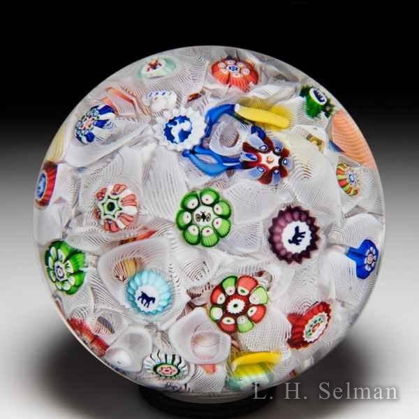 Antique Baccarat 1847 scattered millefiori and Gridel silhouettes glass paperweight. by  Baccarat Antique