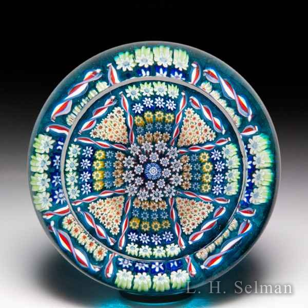 Perthshire Paperweights 1978 patterned millefiori cross faceted glass paperweight. by  Perthshire Paperweights