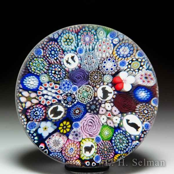 Mike Hunter 2019 close packed millefiori, silhouettes, dancing couple silhouette and flower canes glass paperweight. by Twists Glass Studio