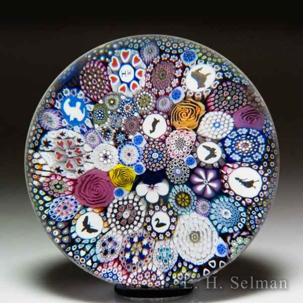 Mike Hunter 2019 close packed millefiori, silhouettes, dancing lady silhouette and flower canes paperweight. by Twists Glass Studio