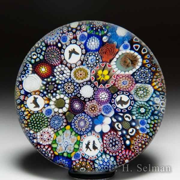 Mike Hunter 2019 close packed millefiori, silhouettes, owl murrina and flower canes glass paperweight. by Twists Glass Studio