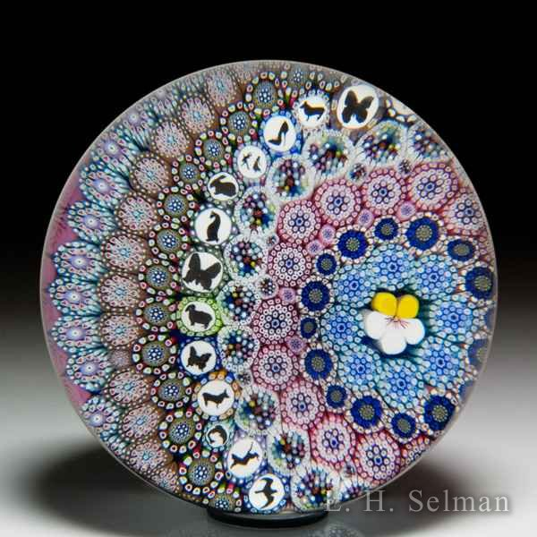 Mike Hunter 2019 off-set close concentric millefiori, roses and silhouette assortment magnum glass paperweight. by Twists Glass Studio