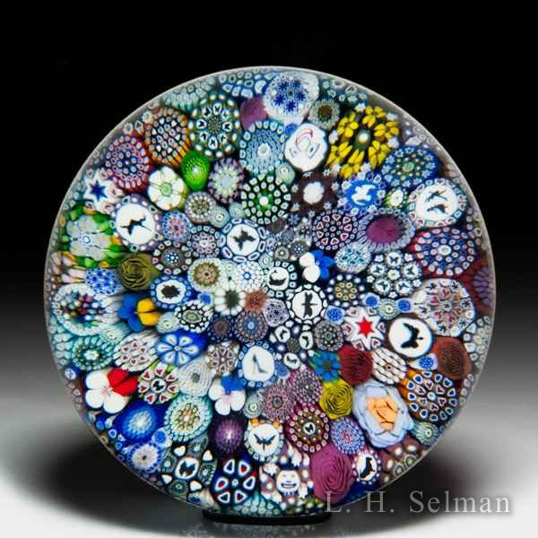 Mike Hunter 2019 close packed millefiori, silhouettes, Dafties and flower canes magnum glass paperweight. by Twists Glass Studio