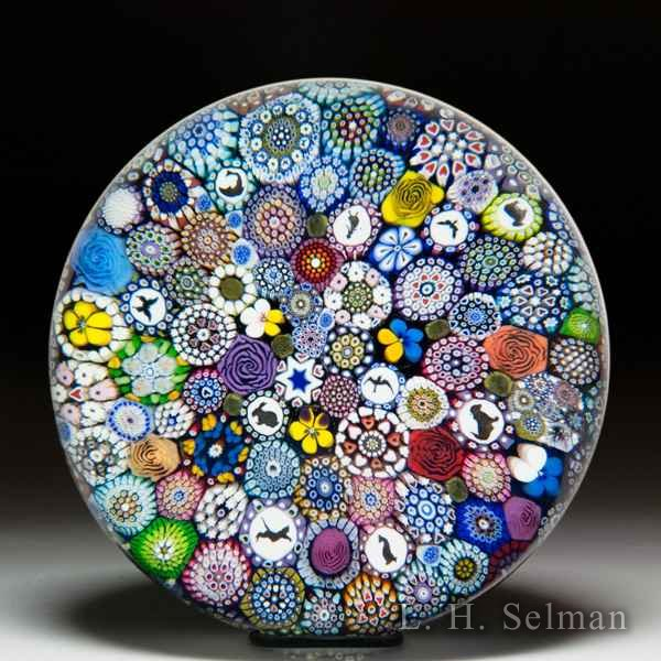 Mike Hunter 2019 close packed millefiori, silhouettes and flower canes magnum glass paperweight. by Twists Glass Studio
