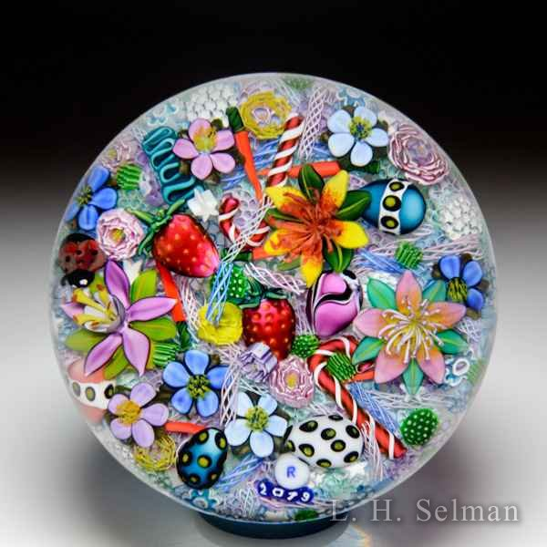 Ken Rosenfeld 2019 end-of-day scrambled millefiori and lampwork flowers, eggs, ladybug, strawberries, carrots and candy canes paperweight. by Ken Rosenfeld