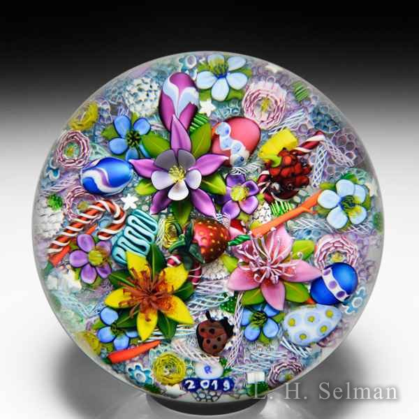 Ken Rosenfeld 2019 end-of-day scrambled millefiori and lampwork flowers, eggs, ladybug, strawberry, raspberry, carrots and candy canes paperweight. by Ken Rosenfeld