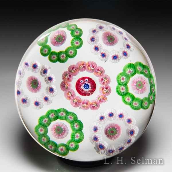 Baccarat 'Dupont' circlet-patterned millefiori glass paperweight. by Baccarat Moderns