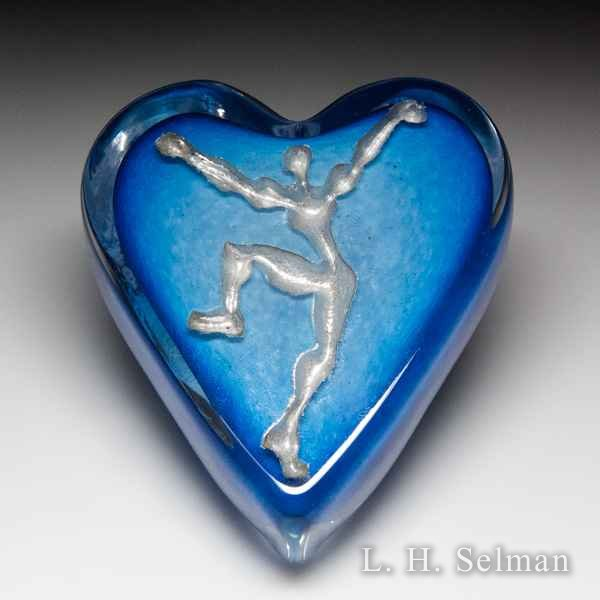 Andrew Fote 'The Seeker' silver inlay figure on blue heart-shaped glass paperweight. by Andrew Fote