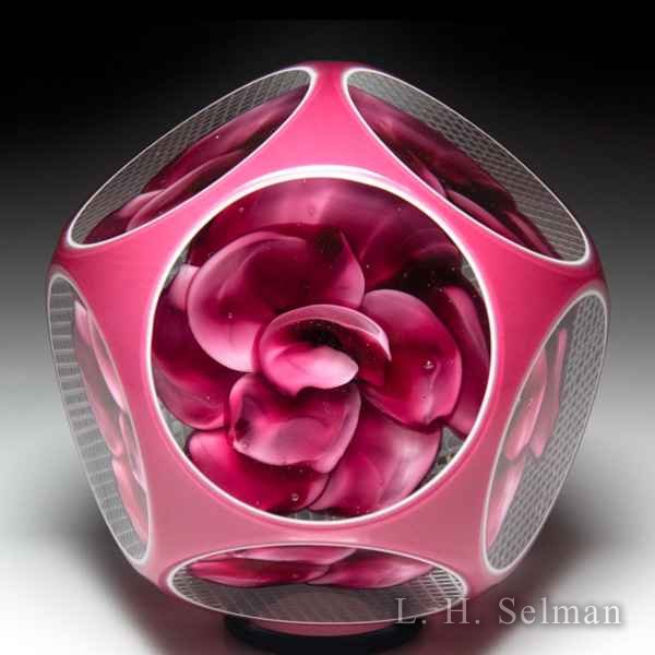 Unidentified pink rose overlay faceted glass paperweight. by  Misc Modern