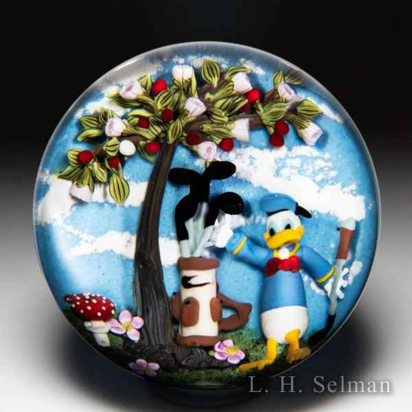 Clinton Smith 2020 Donald Duck golfing paperweight. by Clinton Smith